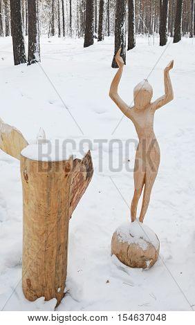 Irkutsk Region, Ru-Jan, 03 2015: Girl on the Ball. Park of wooden sculptures in Savvateevka Village