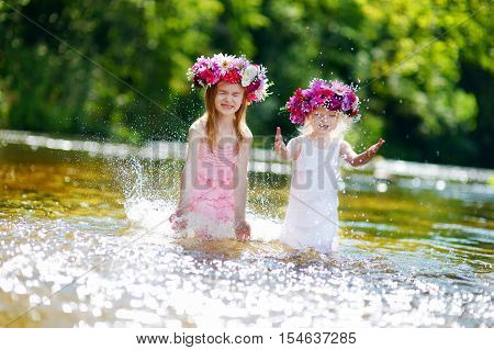 Two Sisters Having Fun By A River