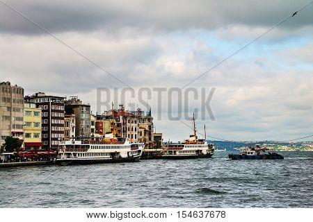 Cruising ship docking on Galata pier on Bosporus Istanbul Turkey in cloudy weather