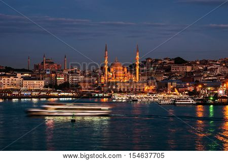 Aerial view of harbor with ships going down the river Bosporus in Istanbul Turkey. Historical part of the city during the day famous Galata bridge and mosques.