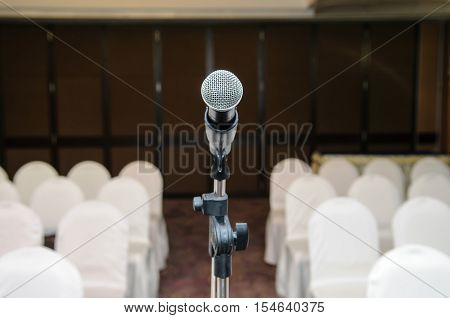 microphone in empty conference room - Stock Photo