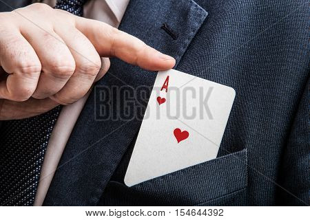 hand pulls the card ace of hearts close up
