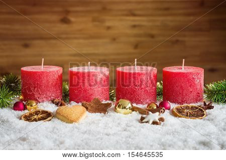 Unlit Advent Candles In Snow