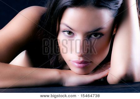 woman portrait, leaned on the hand