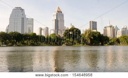 BANGKOK THAILAND-NOV 2 2015: Buildingtrees and pond view around Lumpini park. Center of Bangkok cityThailand. Nov 2 2015.
