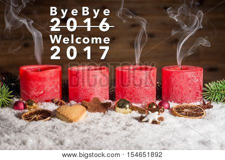 Four Blown Out Advent Candles With Bye Bye 2016 Welcome 2017