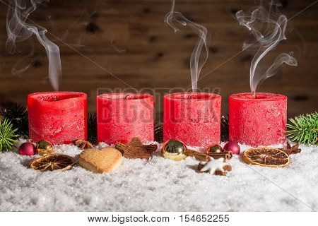 Four Blown Out Advent Candles With Space In Snow