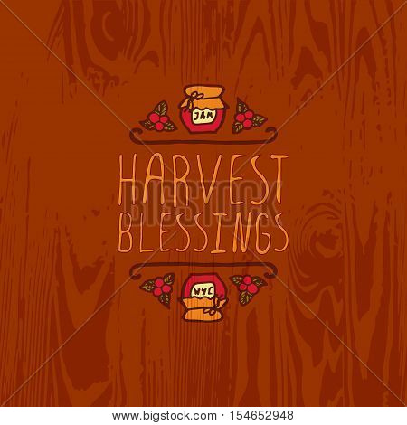 Hand-sketched typographic element with jam, berries and text on wooden background. Harvest blessings