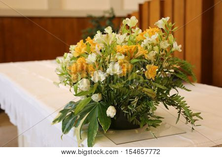 Vase Of Beautiful Flowers On The Altar In The Church