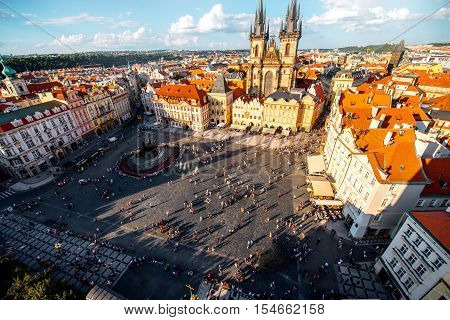 Top cityscape view on the old town square with Tyn cathedral during the sunny day in Prague