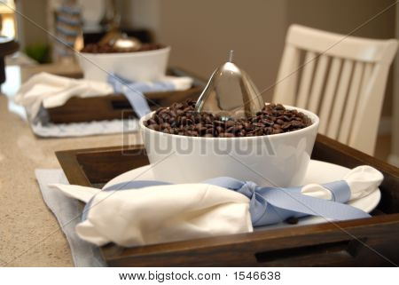Two Dining Place Settings With Coffee Beans On A Marble Counter