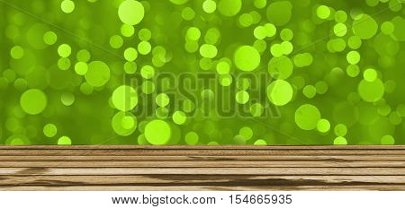 gree light bokeh background or texture and wooden table