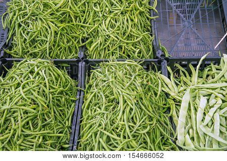 Fresh green peas for sale at a market
