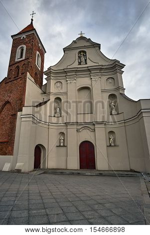 Baroque facade of the church with a Gothic bell tower in Gniezno