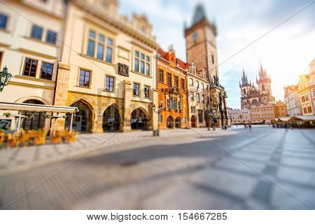Cityscape view on the clock tower and Tyn cathedral during the sunrise in the old town of Prague