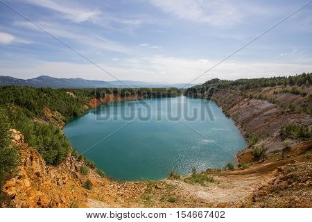 Abandoned open pit quarry mine iron ore blue water