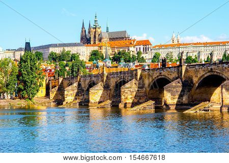 View on the Lesser town with Charles bridge and Vitus church in Prague city