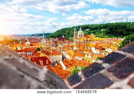 Cityscape top view on the lesser town with saint Nicholas cathedral in Prague