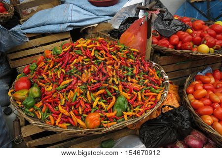 Fresh red, green and yellow chilies at the farmers market, Sucre, Bolivia