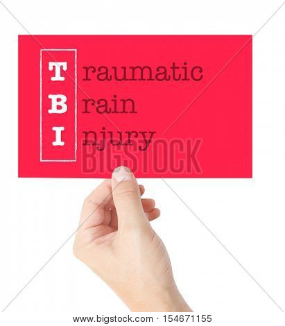 Traumatic Brain Injury explained on a card held by a hand