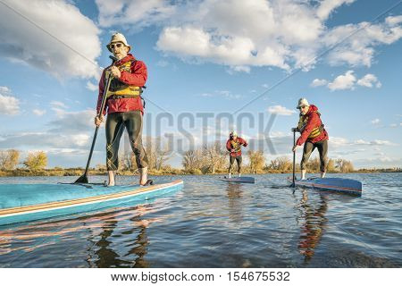 stand up paddling  workout concept - a composite of three images with the same senior male paddler on a lake in Colorado