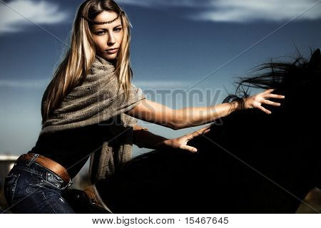 beautiful young blond woman ride  a horse