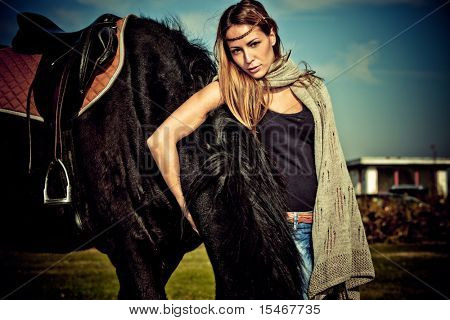 young blond woman outdoor portrait with horse, autumn day poster