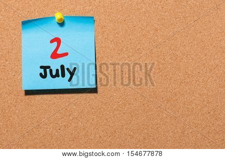 July 2nd. Day 2 of month, color sticker calendar on notice board. Summer time. Empty space for text.