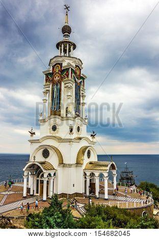 Yalta, Crimea, Russia - May 3, 2016: Orthodox church: museum - lighthouse near Yalta. Monument to lost seamen