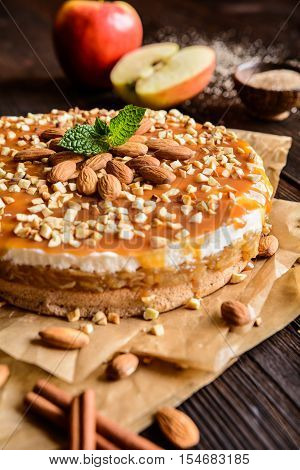 Apple Cake With Whipped Cream, Caramel And Almond Topping