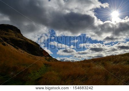 Beautiful view of Arthur's Seat with cloudy skies.