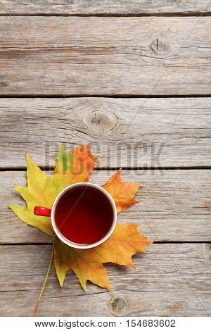 Autumn Leaf With Cup Of Tea On Grey Wooden Table