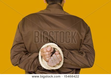 businessman with his hands tiedup (focus on the hands)