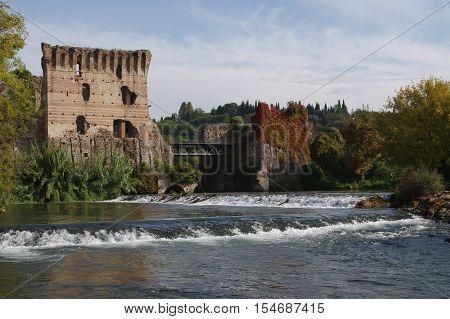 ancient Bridge upon the Mincio river in Borghetto Verona Italy