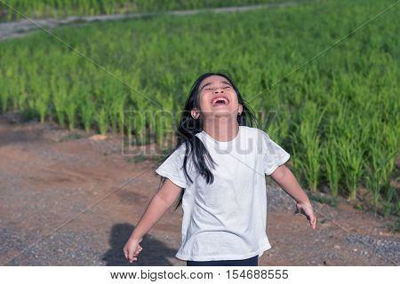 Girl Standing outdoor sunlight,gilr Good mood outdoor