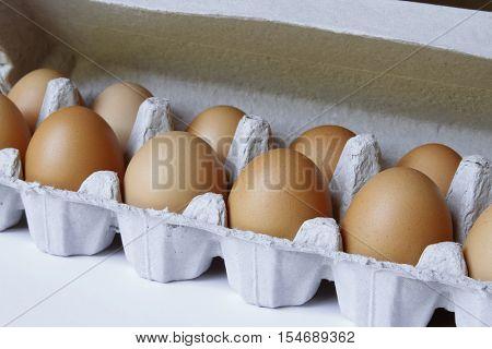 Closeup of eggs in carton