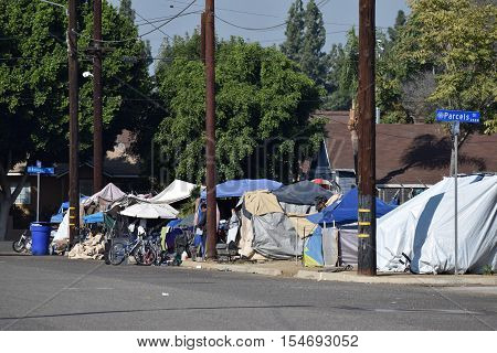 October 22, 2016 in Pomona, CA:  Row of tents at a neighborhood where homeless people reside also known as Tent City where homeless people are allowed to stay and is close to social services taken in Pomona, CA