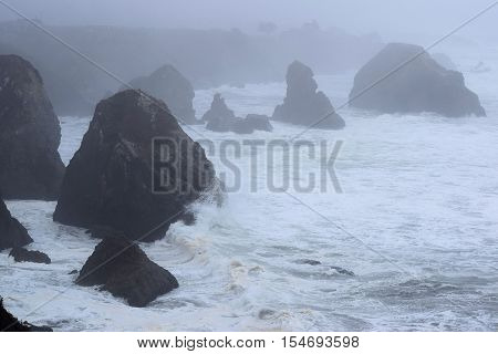 Waves crashing onto rocks during a storm at the rugged California Coastline taken in Bodega Bay, CA