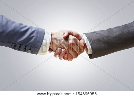 handshake of business partners after signing promising contract poster