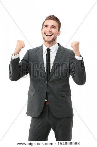 Lucky handsome businessman celebrating. Winner  laughing man