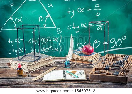 Trigonometry classes in school on old wooden table