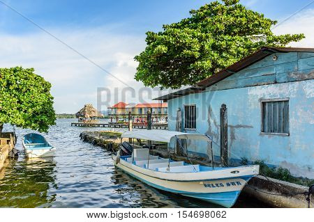 Livingston, Guatemala - August 31 2016: Riverside moored boats in late afternoon light on Rio Dulce in Caribbean town of Livingston Guatemala