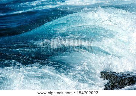 detail shot of wave splashing to the beach