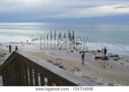 Port Willunga South Australia Australia - October 29 2016: Photographers and other visitors at the jetty ruins at Port Willunga South Australia awaiting sunset.