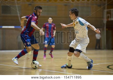 VALENCIA, SPAIN - OCTOBER 28th: Cecilio with ball during Spanish league match between Levante UD FS and Catgas Energia at Cabanyal Stadium on October 28, 2016 in Valencia, Spain