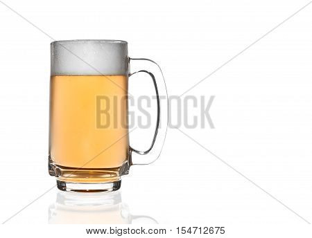 front view frosty ale beer and white bubbles in clear glass with handle and steam for winter drink or celebration isolated on white background and reflection for beer glass with space