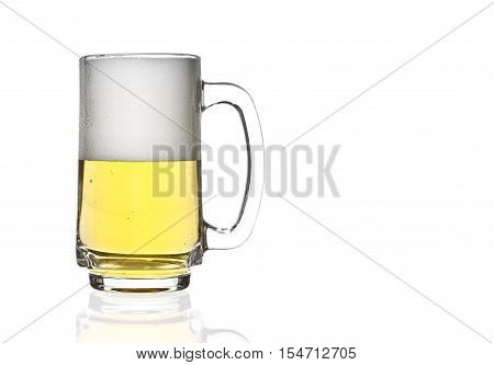 front view frosty lager light beer half glass and white bubbles in clear glass with handle and steam for winter drink or celebration isolated on white background and reflection for beer glass with space
