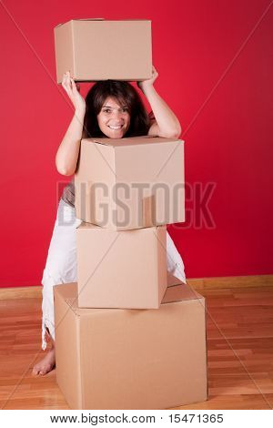 Young women next to cardboard boxes after moving house