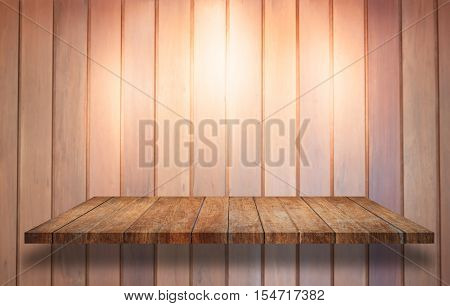 Top of wooden shelf with spot light on wooden wall background, stock photo