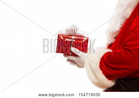 Photo of Santa Claus gloved hands holding red giftbox, isolated on white background Christmas.